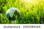 glass globe in the grass. green ... | Shutterstock . vector #1092089264