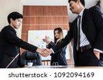 businessmen shaking hands...   Shutterstock . vector #1092094169