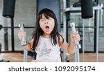 little asian girl working out... | Shutterstock . vector #1092095174