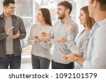 young people applauding during... | Shutterstock . vector #1092101579