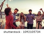 group of friends dancing on a... | Shutterstock . vector #1092105734