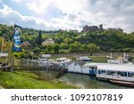 Small photo of Saint Goar, Germany - May 1, 2018: View to famous castle Rheinfels from a promenade. Middle Rhine Valley, Germany