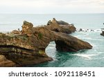Small photo of Biarritz (France). Tourists discover the Rock of the Blessed Virgin.