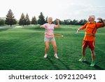 elderly couple in park... | Shutterstock . vector #1092120491