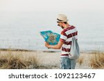 young man standing at the beach ... | Shutterstock . vector #1092123467