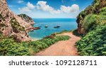 old road to agia eleni beach.... | Shutterstock . vector #1092128711