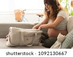 young mother organizing the... | Shutterstock . vector #1092130667