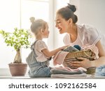 beautiful young woman and child ... | Shutterstock . vector #1092162584