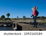 beautiful woman with dslr camera   Shutterstock . vector #1092163184