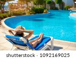 woman in a straw hat relaxing... | Shutterstock . vector #1092169025