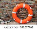 Life Buoy Against Brick Wall