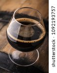 snifter glass with black stout... | Shutterstock . vector #1092193757