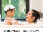 bubble bath time with mom.... | Shutterstock . vector #1092199391
