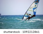surfer sails on the wave ... | Shutterstock . vector #1092212861