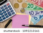 canadian dollar with notepad... | Shutterstock . vector #1092213161