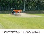 sandblasting of football field | Shutterstock . vector #1092223631