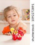 girl putting coins her piggy... | Shutterstock . vector #1092272891