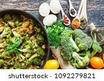 fresh broccoli and orange... | Shutterstock . vector #1092279821