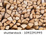 firewood background  chopped... | Shutterstock . vector #1092291995