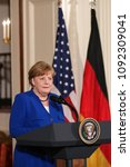 Small photo of Washington, DC - April 27, 2018: German Chancellor Angela Merkel speaks at a press conference in the East Room of the White House alongside US President Donald Trump.