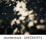 shadow leaves on the concrete... | Shutterstock . vector #1092351971