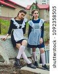 standing schoolgirl with...   Shutterstock . vector #1092358505