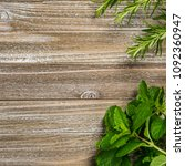 fresh garden herbs on wooden... | Shutterstock . vector #1092360947