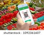 hand holding smartphone to scan ... | Shutterstock . vector #1092361607