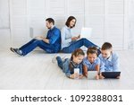 large family with gadgets.... | Shutterstock . vector #1092388031