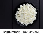 cottage cheese on a dark wooden ... | Shutterstock . vector #1092392561