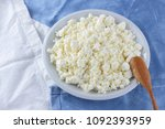 cottage cheese on a white blue... | Shutterstock . vector #1092393959