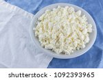 cottage cheese on a white blue... | Shutterstock . vector #1092393965