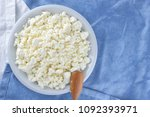cottage cheese on a white blue... | Shutterstock . vector #1092393971