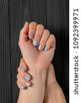 the manicure  blue with silver... | Shutterstock . vector #1092399971