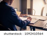 an accountant man holding pen... | Shutterstock . vector #1092410564