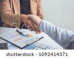 business partnership meeting... | Shutterstock . vector #1092414371