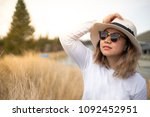 close up head shot of an asian... | Shutterstock . vector #1092452951