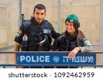 Small photo of 12 May 2018 Via Dolorosa Jerusalem Israel A friendly young Israeli policeman and woman pose for photographs just before the 70 year Independence celebrations.