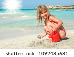 happy child playing by the sea... | Shutterstock . vector #1092485681