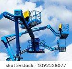 blue aerial platform of cherry... | Shutterstock . vector #1092528077