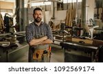 carpenter working at his... | Shutterstock . vector #1092569174