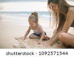 children's day. mom and happy... | Shutterstock . vector #1092571544