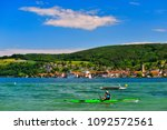 a kayaker on lake constance on... | Shutterstock . vector #1092572561