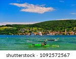 a kayaker on lake constance on... | Shutterstock . vector #1092572567