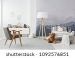 a wooden floor lamp and a... | Shutterstock . vector #1092576851