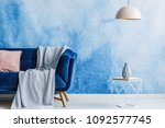 blanket on navy blue sofa in... | Shutterstock . vector #1092577745
