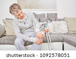 senior woman with crutches and...   Shutterstock . vector #1092578051