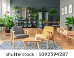 two chairs next to a table on a ...   Shutterstock . vector #1092594287