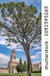 Small photo of Big tree and early christian basilica in Aquileia with famous mosaics, Friuli, Venezia Giulia, Italy