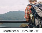 young man trekker enjoy... | Shutterstock . vector #1092605849